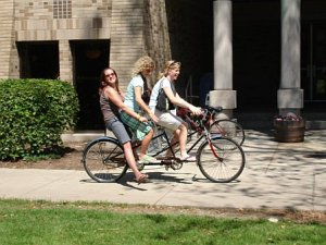 My crazy/wonderful friends Kristi, Emily and Cmac riding a bicycle built for two.