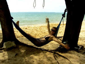 Cait on Otres Beach, outside of Sihanoukville. Yes please, we'll stay forever.