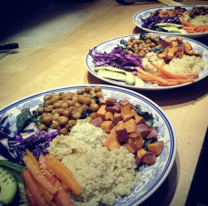 Tonight's feast: quinoa, roasted chickpeas, sweet potatoes, and carrots, kale, hummus, red cabbage, and avocado.